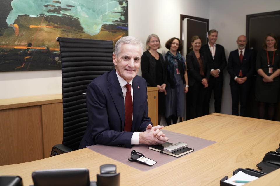 Norway's new Prime Minister Jonas Gahr Store sits in his office in Oslo, Thursday Oct. 14, 2021. Jonas Gahr Store takes over Thursday from the Conservative Party's Prime Minister Erna Solberg, who was ousted in the Sept. 13 election after two four-year terms. (Cornelius Poppe/NTB via AP)