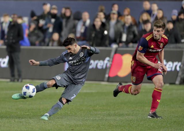 New York City forward David Villa (7) tries to score as Real Salt Lake defender David Horst (4) defends during the second half of an MLS soccer game, Wednesday, April 11, 2018, in New York. NYCFC won 4-0. (AP Photo/Julie Jacobson)