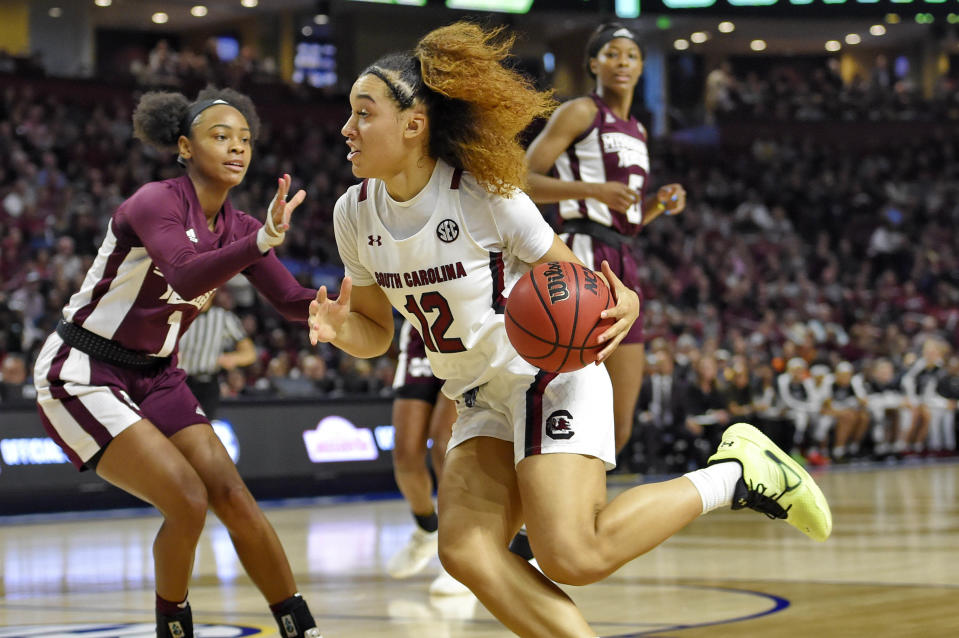FILE - In this March 8, 2020, file photo, South Carolina's Brea Beal (12) drives while defended by Mississippi State's Myah Taylor (1) during a championship match at the Southeastern Conference women's NCAA college basketball tournament in Greenville, S.C. South Carolina is ranked No. 1 in the women's NCAA college basketball poll released Tuesday, Nov. 10, 2020.(AP Photo/Richard Shiro, File)