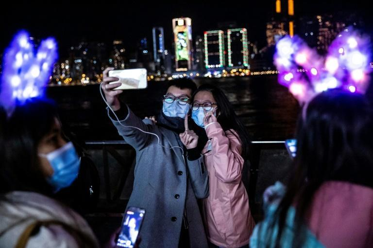A couple in Hong Kong marked the start of 2021 with a selfie on the water front of Victoria Harbour