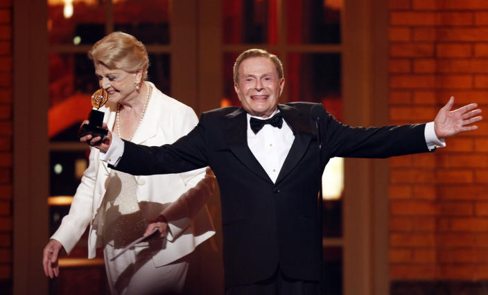 "FILE - In this June 7, 2009, file photo, Jerry Herman accepts his Special Tony Award for Lifetime Achievement in the Theater from Angela Lansbury at the 63rd Annual Tony Awards in New York. Herman, the award winning composer who wrote the cheerful, good-natured music and lyrics for such classic shows as ""Mame,"" ""Hello, Dolly!"" and ""La Cage aux Folles,"" has died. He was 88. (AP Photo/Seth Wenig, FILE)"