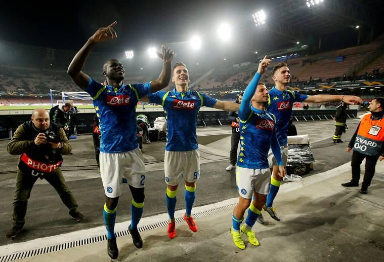 Napoli's Dries Mertens and team mates celebrate after the match