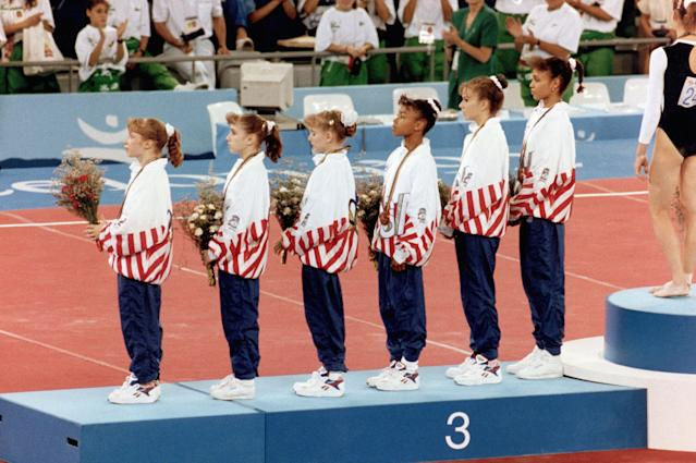 BARCELONA - 1992: (L-R) Kim Zmeskal, Kerri Strug, Shannon Miller, Dominique Dawes, Wendy Bruce and Betty Okino of the United States stand on the podium after winning the Bronze medal in Women's artistic team all-around in gymnastics during the 1992 Summer Olympics in Barcelona, Spain. (Photo by Robert Riger/Getty Images)