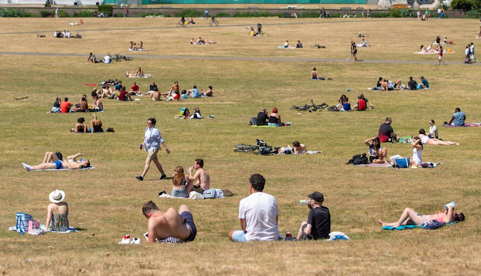 People enjoying the good weather in Greenwich Park, south London, as the public are being reminded to practice social distancing following the relaxation of lockdown restrictions.