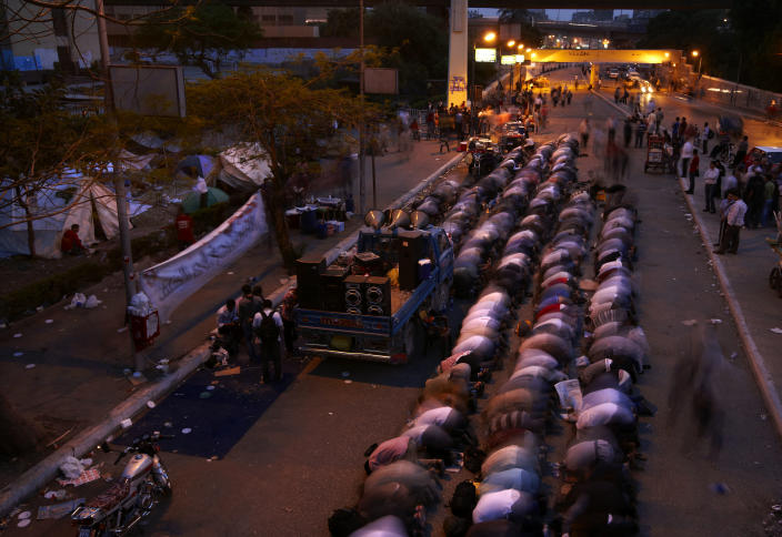 In this Monday, April 30, 2012, photo, followers of Egyptian Muslim cleric and former candidate for Egyptian presidency, Hazem Salah Abu Ismail, pray at the location of their sit down on the road leading to the Defense Ministry, in Cairo, Egypt. (AP Photo/Fredrik Persson)