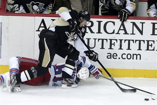 Pittsburgh Penguins center Evgeni Malkin, top, collides with New York Rangers left wing Rick Nash (61) during the first period of an NHL hockey game in Pittsburgh on Friday, April 5, 2013.(AP Photo/Gene J. Puskar)