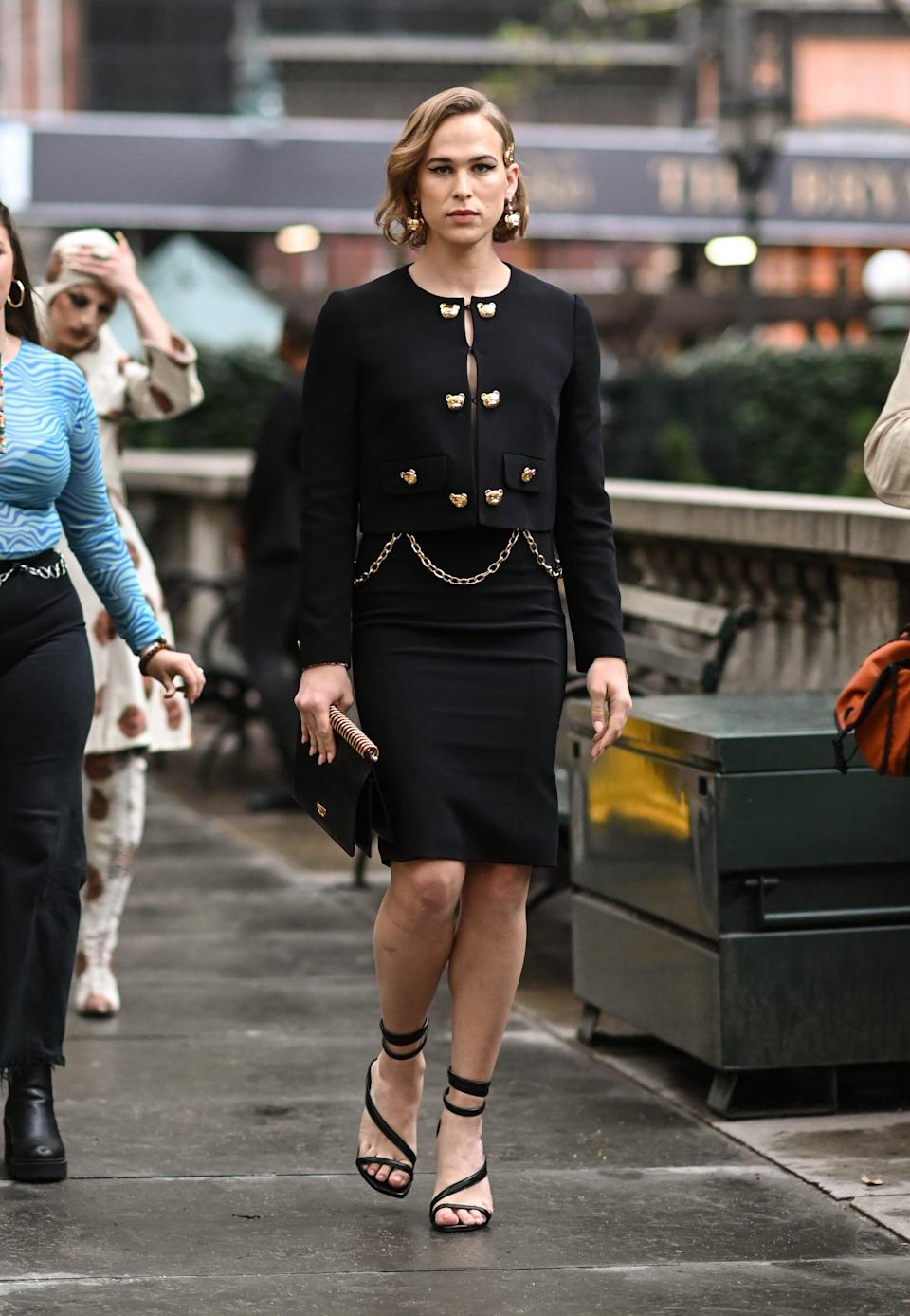 <p>She stunned in a classic black skirt set adorned with Moschino's signature gold teddy bears.</p>