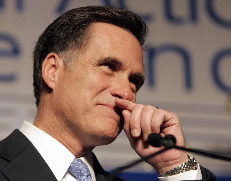 """FILE - In this Feb. 7, 2008, file photo, former Massachusetts Gov. Mitt Romney wipes his lip during a speech before the Conservative Political Action Conference in Washington, where he announced he was suspending his presidential campaign. Romney pulled the plug on his first presidential run and immediately served notice that he wasn't about to fade away. """"I hate to lose,"""" he told conservatives that day. (AP Photo/Steve Helber, File)"""