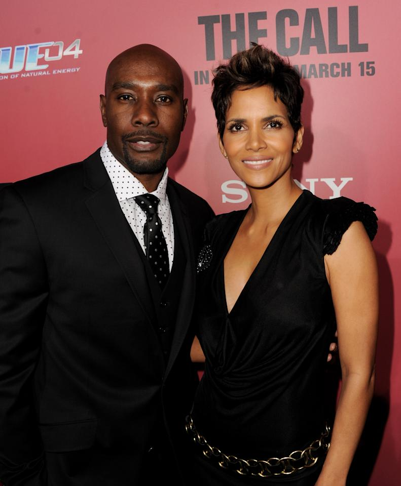 "LOS ANGELES, CA - MARCH 05:  Actors Morris Chestnut (L) and Halle Berry arrive at the premiere of Tri Star Pictures' ""The Call"" at the Arclight Theatre on March 5, 2013 in Los Angeles, California.  (Photo by Kevin Winter/Getty Images)"