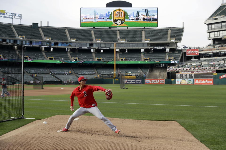 Los Angeles Angels pitcher Shohei Ohtani throws a bullpen session before a baseball game against the Oakland Athletics. (AP)