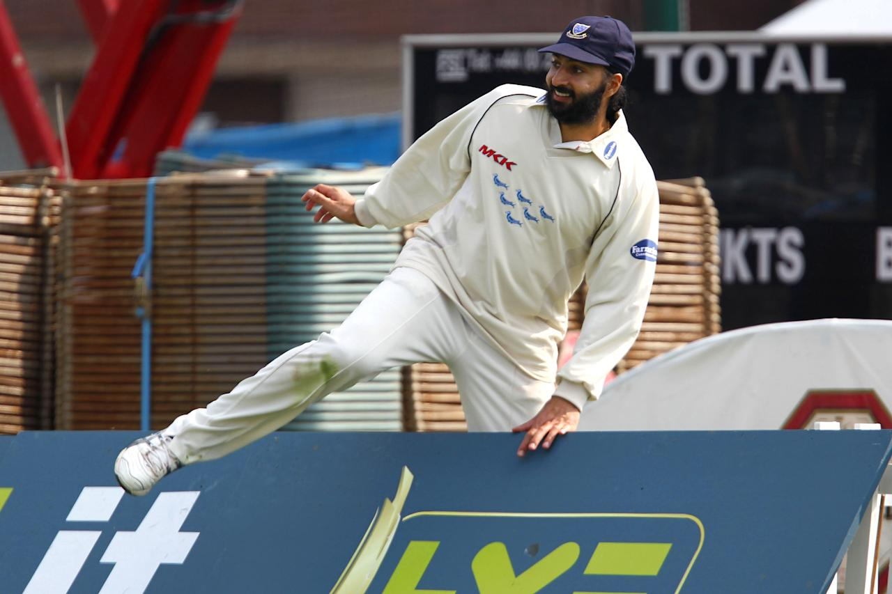 HOVE, ENGLAND - APRIL 15:  Monty Panesar of Sussex retrieves a ball during the LV County Championship Division Two match between Sussex and Surrey at the County Ground on April 15, 2010 in Hove, England.  (Photo by Clive Rose/Getty Images)