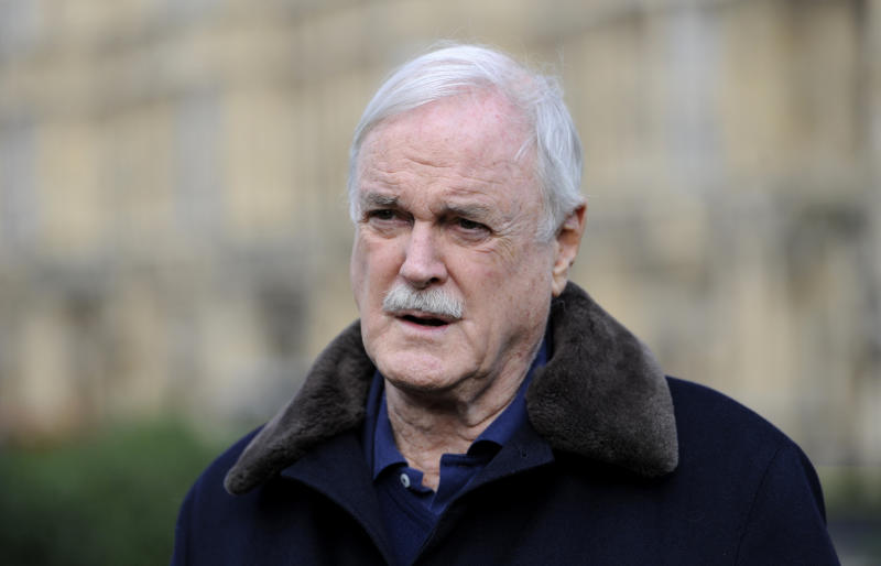 Actor and comedian John Cleese speaks to members of the press on College Green outside the Houses of Parliament after he joined the group 'Hacked Off'.