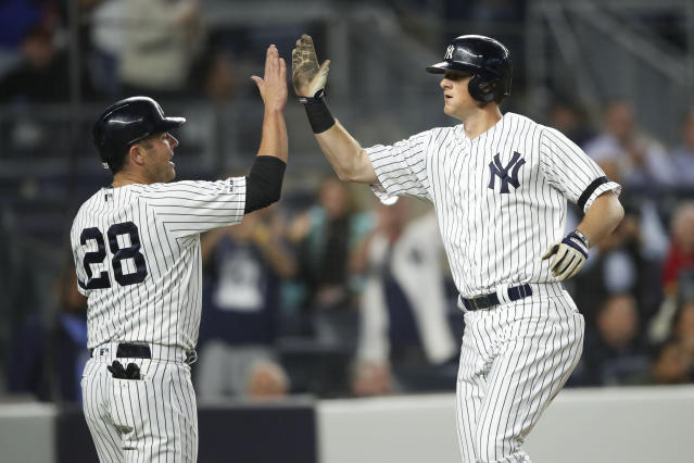 New York Yankees' DJ LeMahieu celebrates with Austin Romine (28) after hitting a three-run home run during the second inning of a baseball game against the Los Angeles Angels, Thursday, Sept. 19, 2019, in New York. (AP Photo/Mary Altaffer)