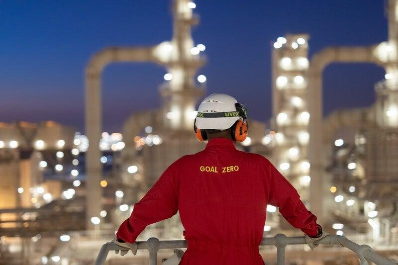 The Pearl GTL plant. An operator viewing the plant at dusk. Doha, Qatar.  (RDS Shell)