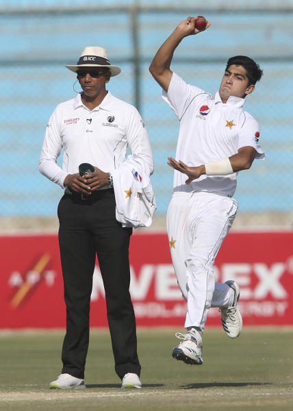 Pakistani bowler Naseem Shah plays against Sri Lanka during the Test in Karachi, Pakistan, Monday, Dec. 23, 2019. Teenager Shah became the youngest fast bowler to take a five-wicket haul in test cricket history as Pakistan completed a winning comeback to tests on home soil with a 1-0 series victory over Sri Lanka on Monday. (AP Photo/Fareed Khan)