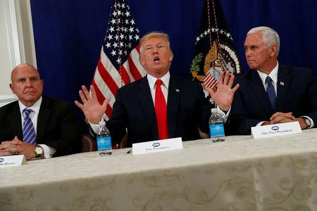U.S. President Donald Trump speaks to reporters after a security briefing with National Security Adviser H.R. McMaster (L) and ?Vice President Mike Pence? (R) at Trump's golf estate in Bedminster, New Jersey U.S. August 10, 2017.  REUTERS/Jonathan Ernst