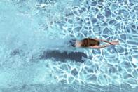 """<p>Swimming is a great <a href=""""https://www.womenshealthmag.com/uk/full-body-workouts/"""" rel=""""nofollow noopener"""" target=""""_blank"""" data-ylk=""""slk:full-body workout"""" class=""""link rapid-noclick-resp"""">full-body workout</a> that can leave you physically stronger, with a healthier heart, too. Plus, depending on where you like to swim, it can be budget-friendly, too. Although lidos, indoor and <a href=""""https://www.womenshealthmag.com/uk/fitness/fitness-holidays/g32877161/outdoor-pools-near-me/"""" rel=""""nofollow noopener"""" target=""""_blank"""" data-ylk=""""slk:outdoor pools"""" class=""""link rapid-noclick-resp"""">outdoor pools</a> are closed at the moment, summer is coming and better weather means that, when they're given the green light, outdoor swims are back on the cards. </p><p class=""""body-text"""">Regular pool attendance could make you smarter, improve your mental health and enhance your lung capacity, and that's not all. According to the <a href=""""https://www.nhs.uk/live-well/exercise/swimming-for-fitness/"""" rel=""""nofollow noopener"""" target=""""_blank"""" data-ylk=""""slk:NHS"""" class=""""link rapid-noclick-resp"""">NHS</a>, adding a weekly pool workout to your training plan can reduce the risk of chronic illnesses, such as heart disease, type 2 diabetes and strokes. You can also expect full-body toning and improved stamina, which translates nicely into improved overall fitness levels and capabilities. Cross-training (exercising in different ways) is a fantastic way to improve your overall fitness. </p><p class=""""body-text"""">Women's Health spoke to Emily Morrissey, an instructor for <a href=""""https://www.swimmingnature.com/sn-public/"""" rel=""""nofollow noopener"""" target=""""_blank"""" data-ylk=""""slk:Swimming Nature"""" class=""""link rapid-noclick-resp"""">Swimming Nature</a>, to glean her expert know-how on the benefits of swimming and find out exactly what to look forward to when the world opens up again. </p>"""