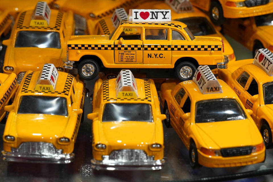 New York Yellow Cab toy cars are on display for sale at a gift shop in Lower Manhattan, Tuesday, Nov. 17, 2020. In souvenir shops from Times Square to the World Trade Center, shelves full of T-shirts and trinkets still love New York, as the slogan goes. But the proprietors wonder when their customers will, again. The coronavirus has altered many aspects of life and business in the United States' biggest city, and the pandemic is taking a major toll on the gifts-and-luggage stores that dot tourist-friendly areas. After setting records year after year since 2010, travel to New York has plummeted during the pandemic. (AP Photo/Mary Altaffer)