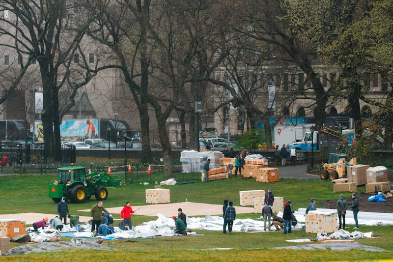 Workers set up a field hospital inside Central Park in front of Mount Sinai Hospital on March 29, 2020.