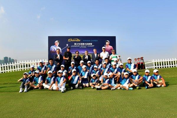 Legendary professional golfer Phil Mickelson, rising Chinese golf star Li Haotong, and officiating guests pose with young golfers in Macao at a junior golf clinic Monday.