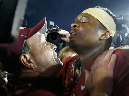 Florida Seminoles head coach Jimbo Fisher (L) celebrates with quarterback Jameis Winston after they defeated the Auburn Tigers to win the BCS Championship football game in Pasadena, California January 6, 2014. REUTERS/Lucy Nicholson