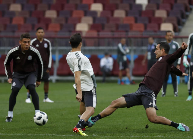 Mexico's Andres Guardado, center, and Mexico's Rafael Marquez, right, compete for the ball during Mexico's official training on the eve of the group F match between Germany and Mexico at the 2018 soccer World Cup in the Luzhniki Stadium in Moscow, Russia, Saturday, June 16, 2018. (AP Photo/Eduardo Verdugo)