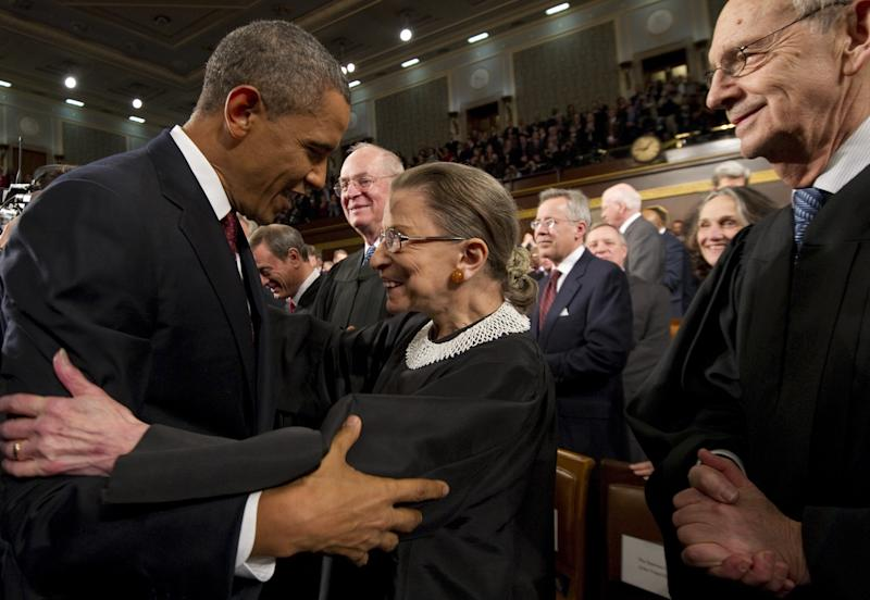 President Barack Obama greets Supreme Court Justice Ruth Bader Ginsburg before his State of the Union address in 2012 (Getty Images)
