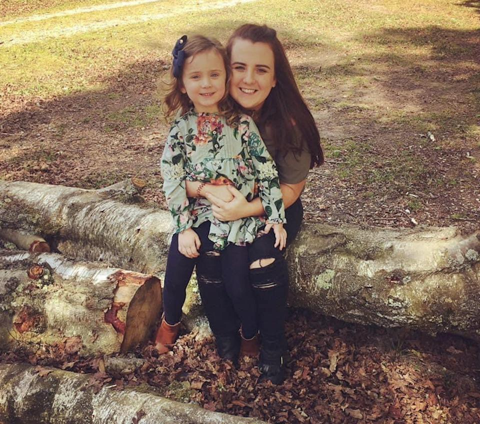 Nicole Moore and her daughter Tilly hugging in a park