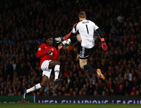 Bayern Munich's Neuer is challenged by Manchester United's Welbeck during their Champions League quarter-final first leg soccer match at Old Trafford in Manchester