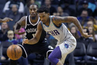 Charlotte Hornets' Malik Monk (1) chases down a loose ball before Brooklyn Nets' Iman Shumpert (10) can recover during the second half of an NBA basketball game in Charlotte, N.C., Friday, Dec. 6, 2019. The Nets won 111-104. (AP Photo/Bob Leverone)