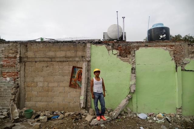 "<p>Jaime Delgado, 21, an agricultural worker, poses for a portrait on rubble in an area where he helped rescue people, after an earthquake in Jojutla de Juarez, Mexico, September 30, 2017. His house was not damaged. ""A lady died here, crushed by the rubble. All this is over, now I searches pieces of iron to sell. My economic situation is bad"", Delgado said. (Photo: Edgard Garrido/Reuters) </p>"
