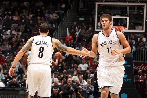 BROOKLYN, NY - JANUARY 5: Deron Williams #8 and Brook Lopez #11 of the Brooklyn Nets congratulate each other during a game played against the Sacramento Kings on January 5, 2013 at the Barclays Center in the Brooklyn borough of New York City. (Photo by Nathaniel S. Butler/NBAE via Getty Images)