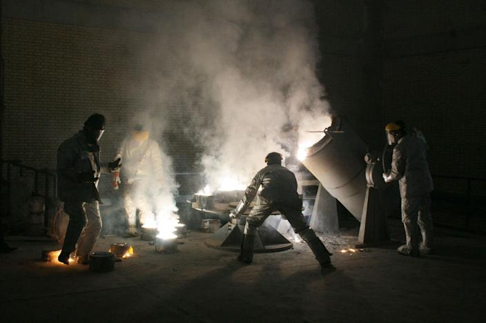 Men work inside of an uranium conversion facility March 30, 2005, outside the city of Isfahan, about 254 miles (410 kilometers) south of capital Tehran, Iran. The cities of Isfahan and Natanz in central Iran are home to the heart of Iran's nuclear program. (Photo: Getty Images)