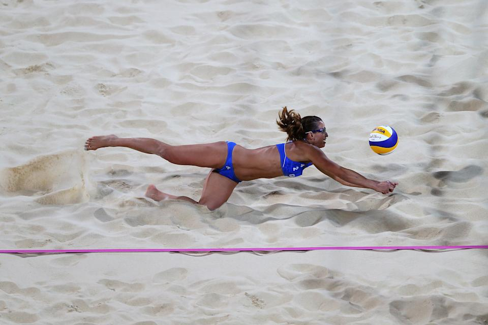 LONDON, ENGLAND - JULY 28: Vasiliki Arvaniti of Greece dives for the ball against Switzerland during the Women's Beach Volleyball Preliminary Round between Switzerland and Greece on Day 1 of the London 2012 Olympic Games at Horse Guards Parade on July 28, 2012 in London, England. (Photo by Ryan Pierse/Getty Images)