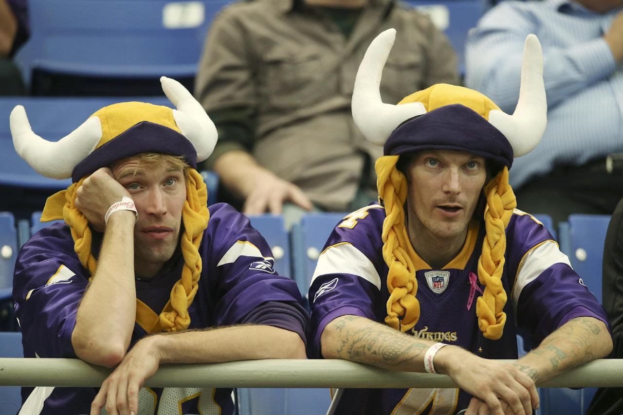 Minnesota Vikings fans Shawn Maydole, left, and Kris Johnson of Brainerd, Minn.,  watch late in the fourth quarter as the Vikings trail the Carolina Panthers late in the fourth quarter Sunday Oct. 12, 2013, in Minneapolis. Vikings  lost 35-10.  (AP Photo/The Star Tribune, Jeff Wheeler)