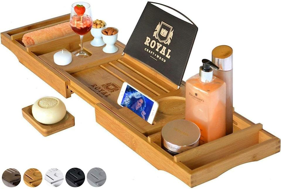 <p>If you want to read, listen to music, watch TV, or have a drink, you need this <span>Royal Craft Wood Luxury Bathtub Caddy Tray</span> ($50, originally $60) in your life.</p>
