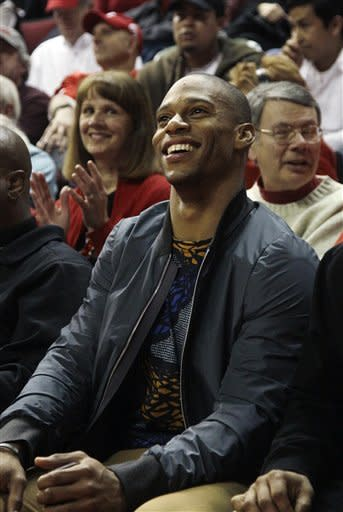 New York Giants wide receiver Victor Cruz, of Paterson, N.J. sits in the stands during the first half of an NCAA college basketball game between Seton Hall and Rutgers in Piscataway, N.J., Wednesday, Feb. 8, 2012. (AP Photo/Mel Evans)