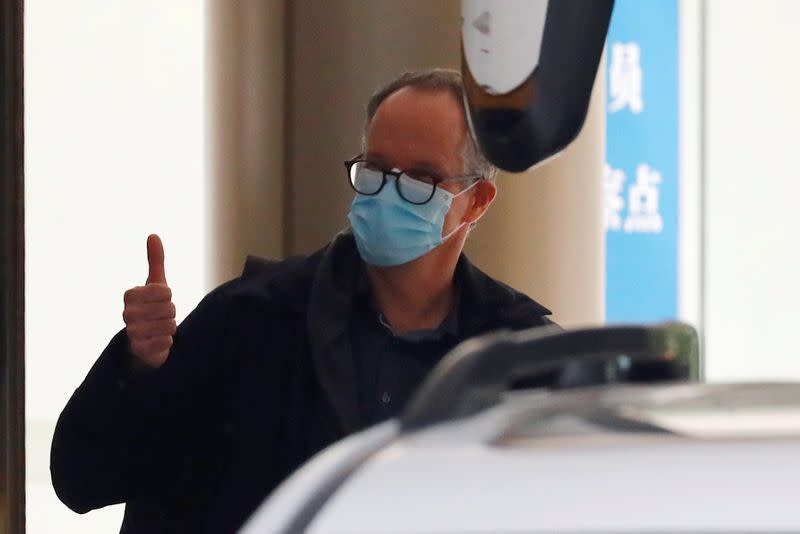 WHO team member tasked with investigating the origins of the coronavirus disease (COVID-19) pandemic leaves quarantine hotel in Wuhan