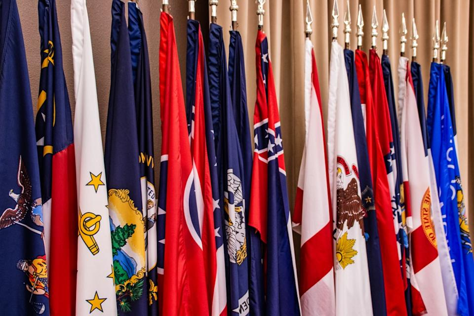 A row of flags from many states.