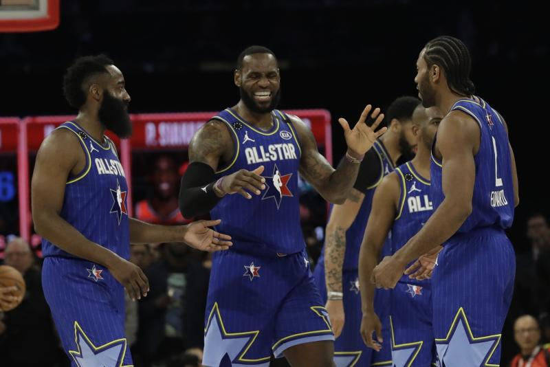 LeBron James of the Los Angeles Lakers celebrates with James Harden of the Houston Rockets and Kawhi Leonard of the Los Angeles Clippers during the second half of the NBA All-Star basketball game Sunday, Feb. 16, 2020, in Chicago. (AP Photo/Nam Huh)