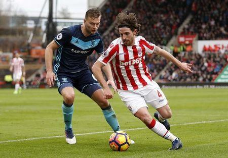 Stoke City's Joe Allen in action with Middlesbrough's Ben Gibson