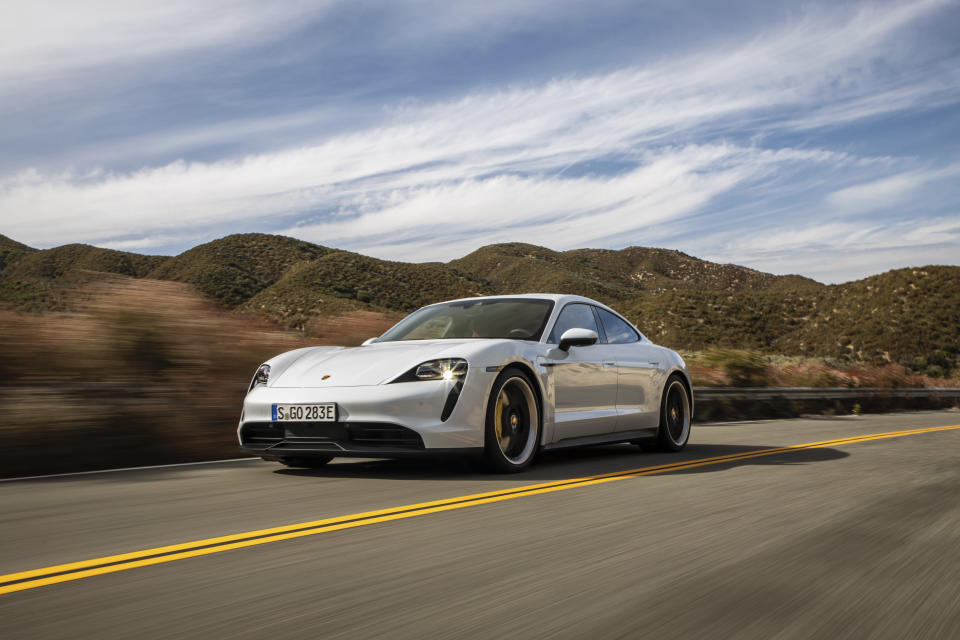 This photo provided by Porsche shows the 2020 Porsche Taycan, a premium electric sedan with an estimated range of 227 miles. Edmunds has noted that this car is capable of getting more range in real-world conditions. (Courtesy of Porsche Cars North America via AP)
