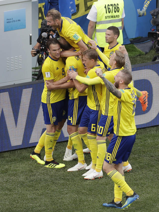 Sweden's players celebrate after scoring their side's first goal during the group F match between Sweden and South Korea at the 2018 soccer World Cup in the Nizhny Novgorod stadium in Nizhny Novgorod, Russia, Monday, June 18, 2018. (AP Photo/Michael Sohn)