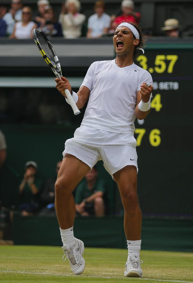 Rafael Nadal of Spain celebrates as he defeated Lukas Rosol of Czech Republic in their men's singles match on Centre Court at the All England Lawn Tennis Championships in Wimbledon, London, Thursday, June 26, 2014. (AP Photo/Pavel Golovkin)