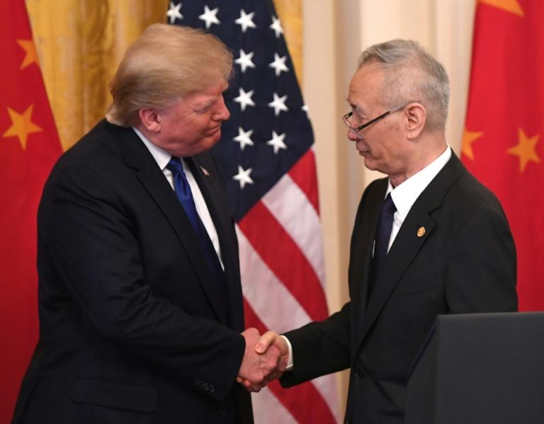 China's Vice Premier Liu He, pictured with President Donald Trump, has led Beijing's trade negotiations with Washington (AFP Photo/SAUL LOEB)