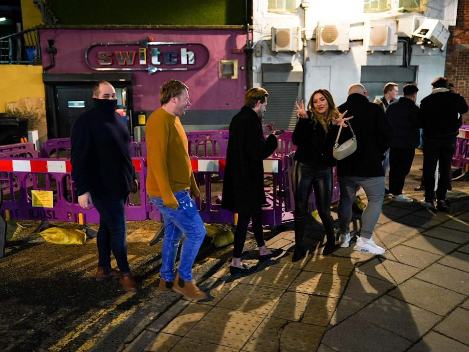Customers wait outside the Switch bar in Newcastle as it prepares to serve customers after midnight to mark the latest lifting of lockdown measures (Getty Images)
