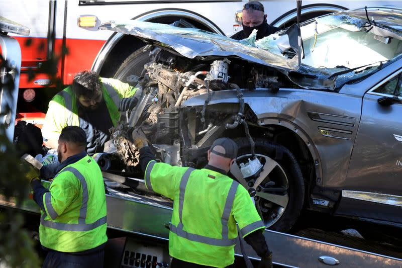 FILE PHOTO: The vehicle of golfer Tiger Woods is loaded onto a recovery truck in Los Angeles