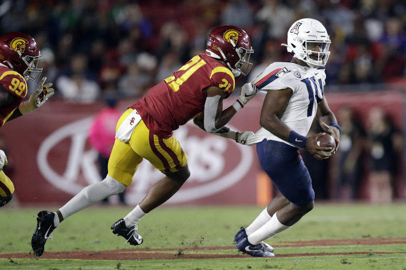 Arizona quarterback Khalil Tate, right, is sacked by Southern California safety Isaiah Pola-Mao (21) during the first half of an NCAA college football game Saturday, Oct. 19, 2019, in Los Angeles. (AP Photo/Marcio Jose Sanchez)