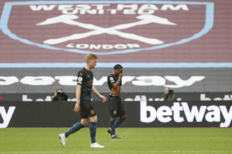 Manchester City's Raheem Sterling, right, and Kevin De Bruyne walk off the pitch at the end of the English Premier League soccer match between West Ham and Manchester City, at the London Olympic Stadium Saturday, Oct. 24, 2020. The game ended in a 1-1 draw. (Paul Childs, Pool via AP)