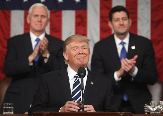 <p>U.S. Vice President Mike Pence (L) and Speaker of the House Paul Ryan (R) applaud as U.S. President Donald J. Trump (C) delivers his first address to a joint session of the U.S. Congress on February 28, 2017 in the House chamber of the U.S. Capitol in Washington, D.C. (Jim Lo Scalzo/Getty Images) </p>